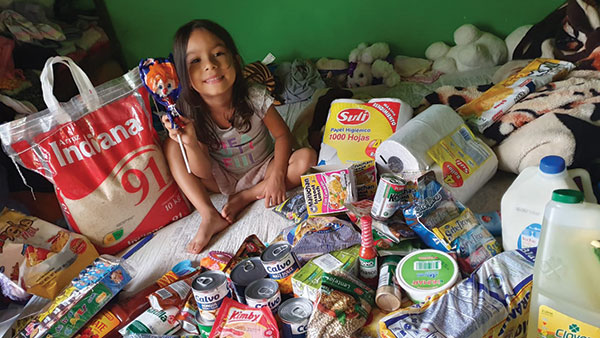 Girl surrounded by food