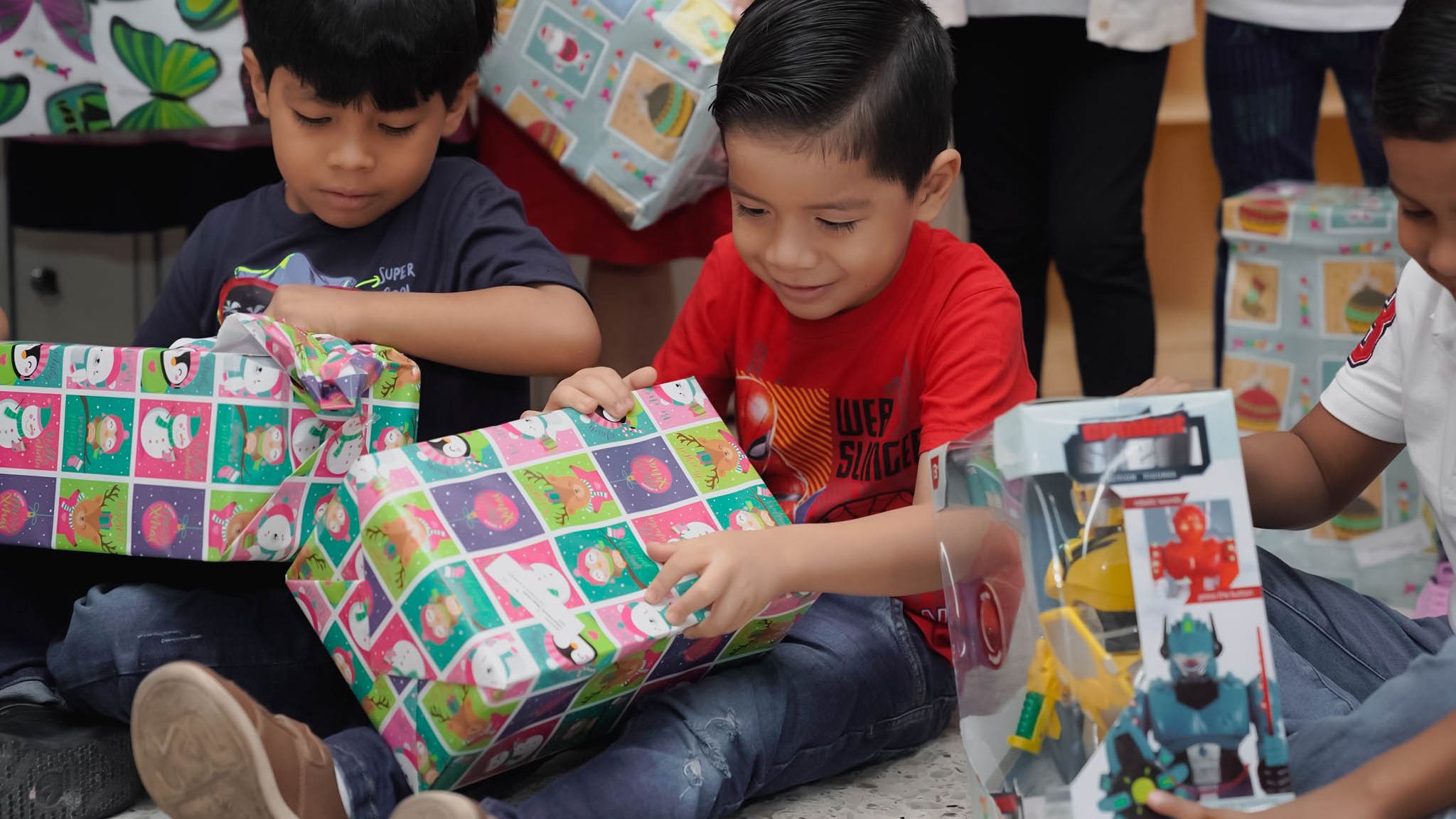 little boys opening presents and smiling