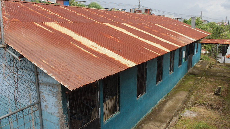 School building with dilapidated roof